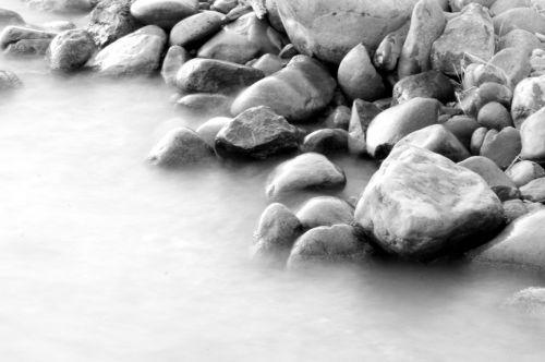 Rocks In Water Flow