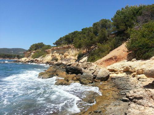 rocky beach ibiza freedom