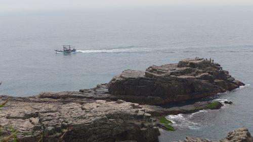 rocky shore boat landscape