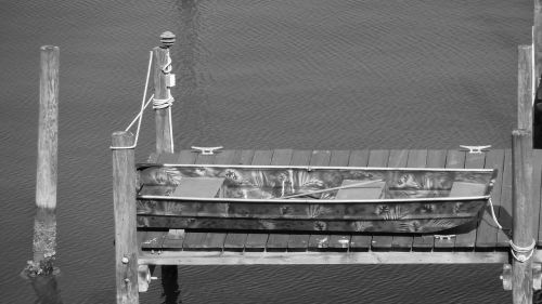 rowboat black and white pier