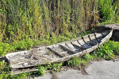 rowboat debris barge