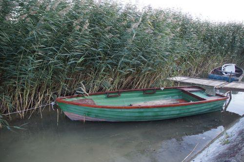 rowboat barge reed