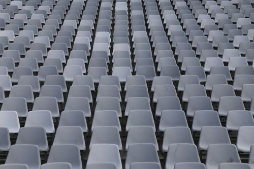 rows of seats sit auditorium