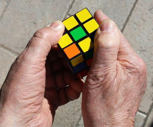 rubik's cube hands yellow