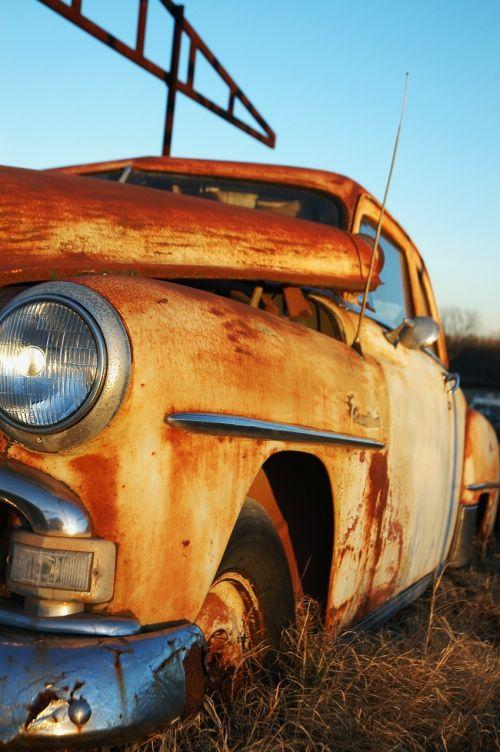 rusty car abandoned junkyard