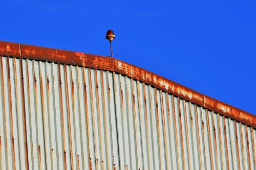 Rusty Hanger Against Blue Sky