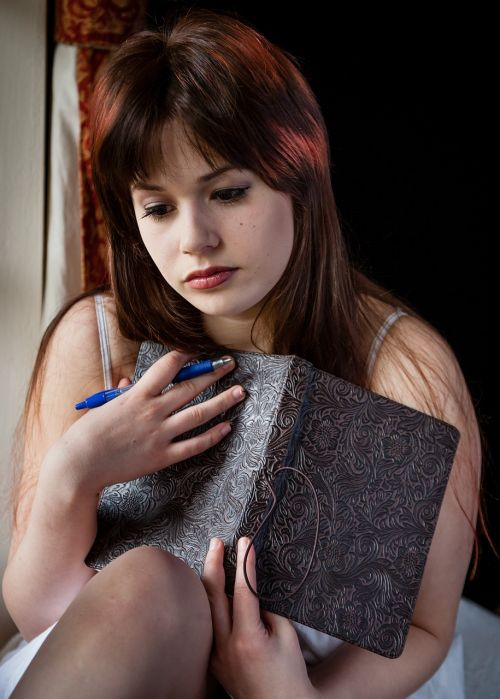 sad woman writing diary