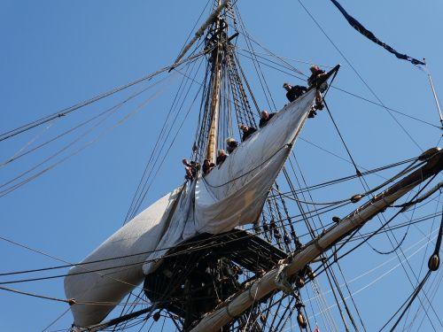 sailing sailing boat hoist the sails