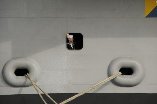 sailor observing mooring