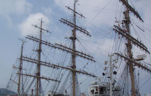 sailors rigging sailing ship
