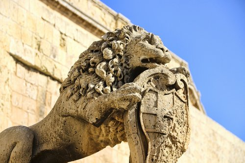 sand stone  coat of arms  lion