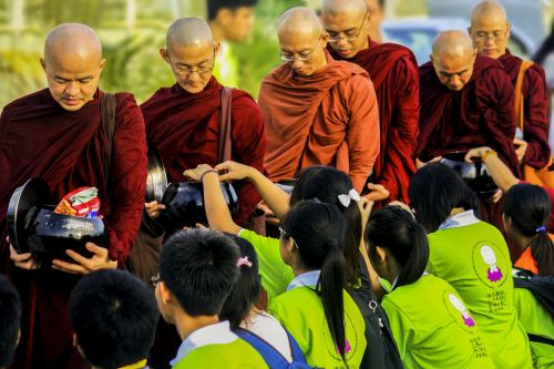 sangha theravada monks in alms-round offering to the sangha