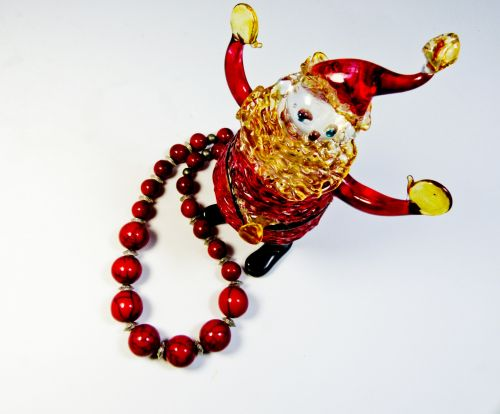 Santa Figurine And Red Necklace