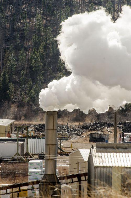 sawmill sawmill smokestack smoke