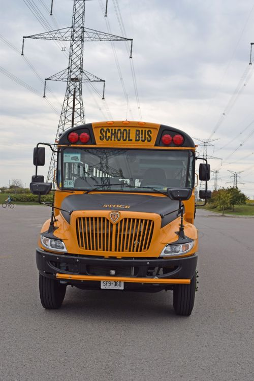school bus front school