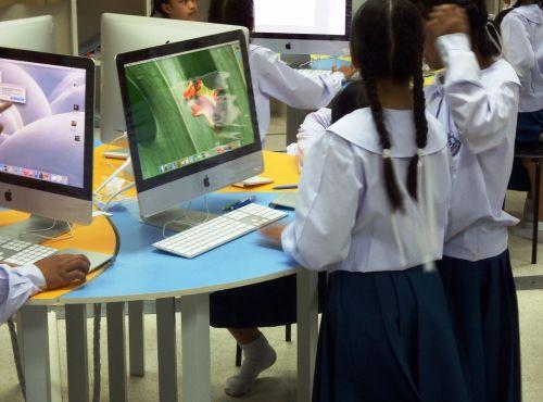 School Students Using Apple Mac