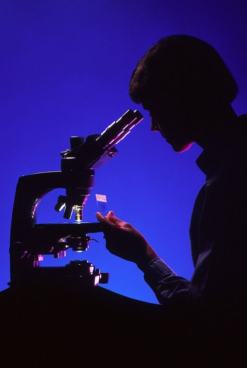 scientist with microscope silhouettes laboratory
