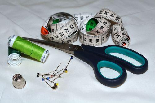scissors tape measure thread