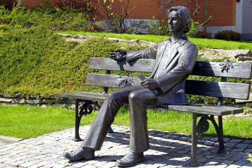 sculpture bench sit down