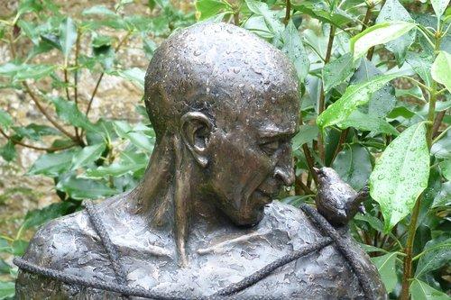 sculpture  man and bird  contemplative