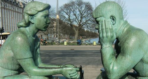 sculpture couple speak