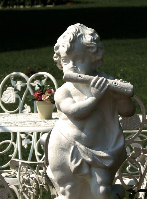 sculpture stone figure flautist