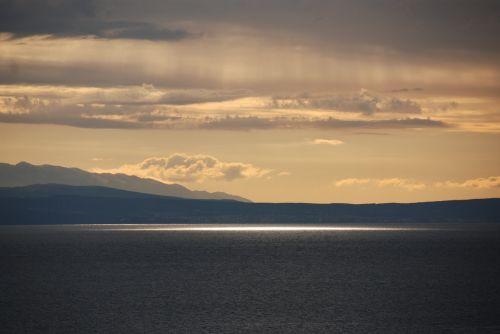 sea sunbeam clouds