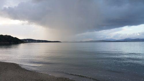 sea downpour sun
