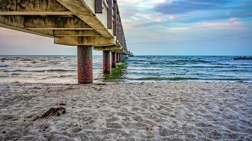 sea bridge  pillar  beach