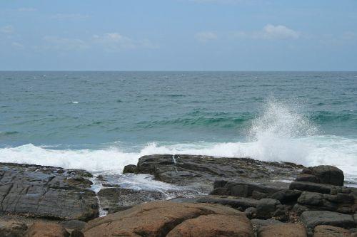 Sea Spray Splashing Against Rock