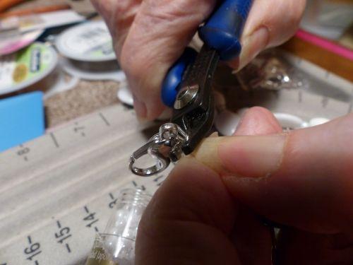 Senior Woman Crimping Beads