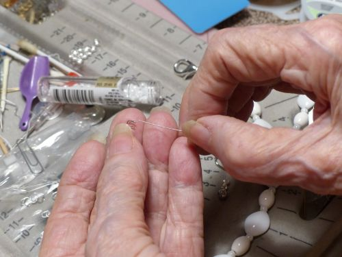 Senior Woman Threading Beads