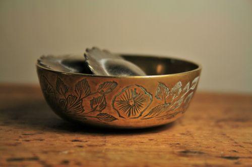 Serviette Rings Lying In Brass Bowl