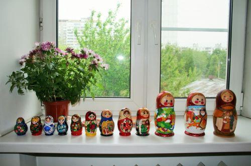 Sets Of Matrioshkas On A Windowsill