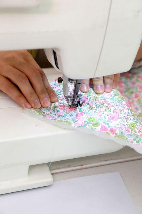 sewing machine sewing fabric