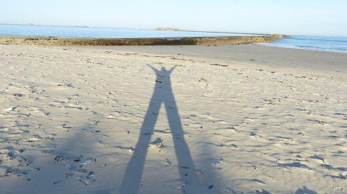 shadow man human shadow in sand shadow play
