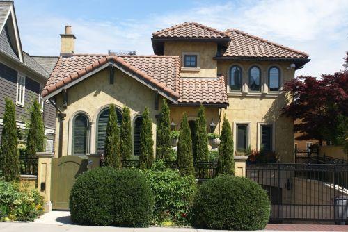 Shingled Roof On Yellow House