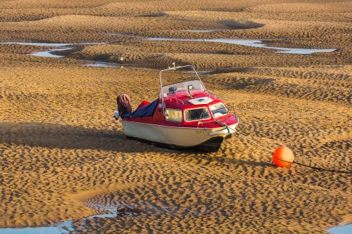 ship low tide sea