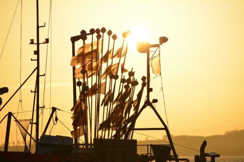ship sunset flags