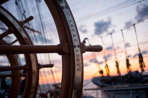 ship helm sunset cutter
