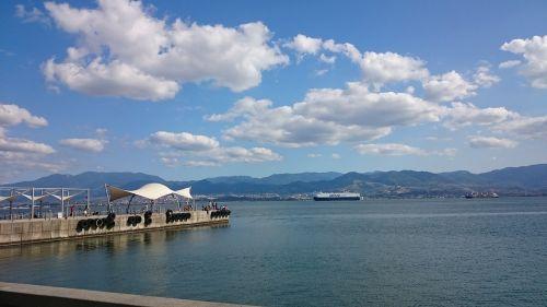 ships seaside blue sky