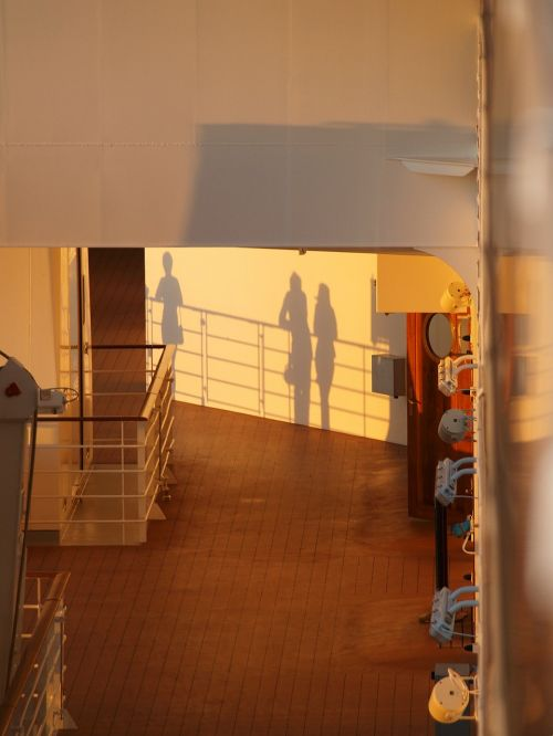 ship's rail sunset shadow