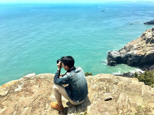 shooting handsome guy the sea