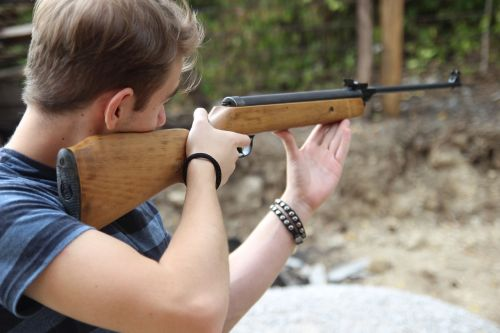 shooting man rifle