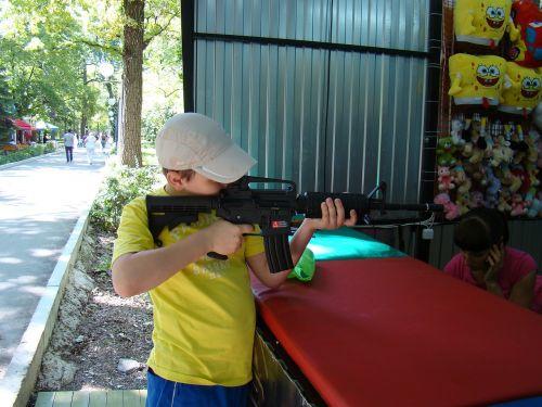 shooting gallery attraction boy