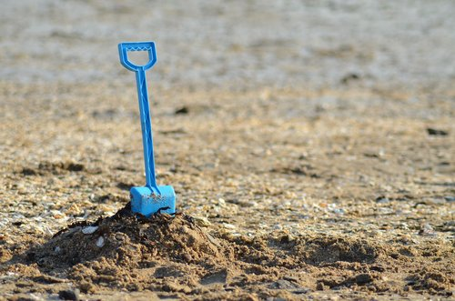 shovel  sand  sea