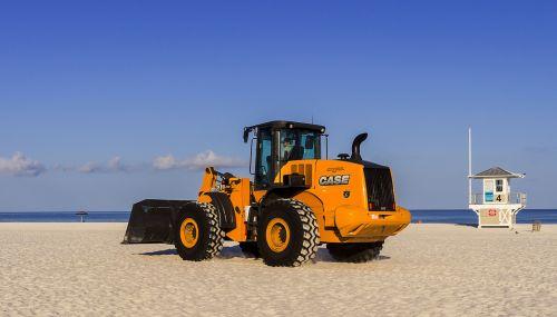 shovel mechanics worker beach cleaning