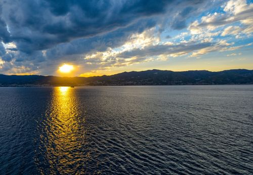 sicily,sunset,sky,clouds,blue,boat,sun,rays,sea,mediterranean,travel,water,reflection,dusk,outdoors,bay,light,italy