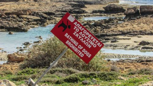 sign strange beach