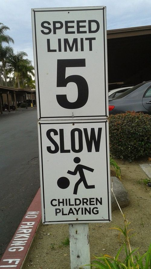 sign speed limit slow children playing